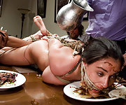 Tied busty brunette services a dinner party