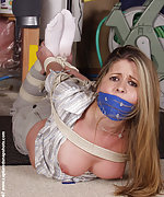 Roped, over-the-mouth gagged, stripped