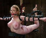 Big titted flexible blonde is hogtied and suspended