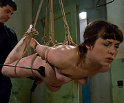 Naked beauty gets roped, pegged, gagged and vibed