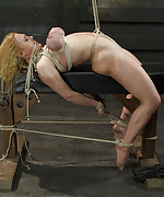 Blonde with huge tits suffers through the most intense bondage